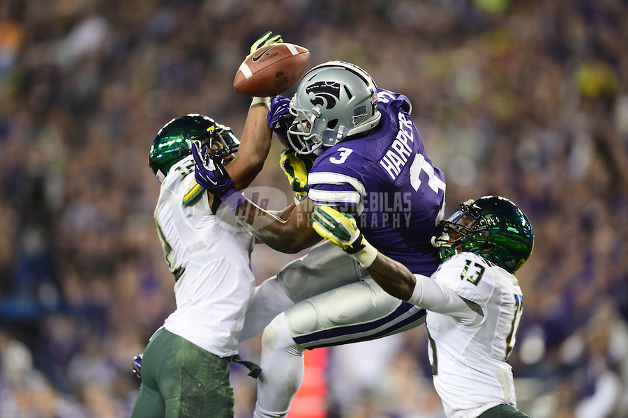 Jan. 3, 2013; Glendale, AZ, USA: Kansas State Wildcats wide receiver Chris Harper (3) has a touchdown pass broken up by Oregon Ducks safety Brian Jackson (12) and cornerback Troy Hill (13) in the second quarter during the 2013 Fiesta Bowl at University of Phoenix Stadium. Mandatory Credit: Mark J. Rebilas-