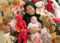Mother and baby daughter surrounded by bears the mother crafted.