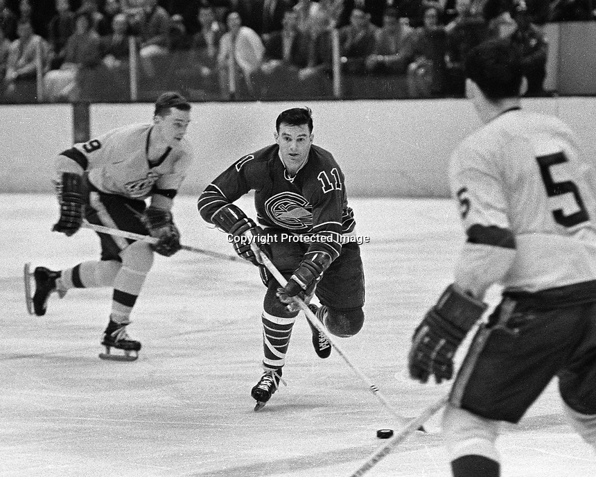 Seals #11 Ted Hampson or Gerry Odrowski..skates against the LA Kings.Kings #9 Real Lemieux, and #5 Dave Amadio. .1968 photo/Ron Riesterer