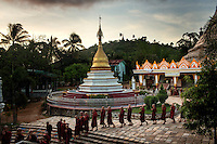 Monks from the Myazeda Man Oo Monastery, where they produce promotional material and literature for the Buddhist nationalist 969 movement, file into evening prayers in Mawlamyine, Mon State. /Felix Features
