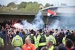 Visiting fans confronting police and home supporters in front of the main stand at Key's Park after the Hednesford Town versus FC United of Manchester Northern Premier League premier division play-off final. The match would decide which club were promoted to the Blue Square Conference North. Hednesford won the game by 2 goals to 1 in front of a stadium record attendance of 4412 spectators.