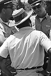 Martin Luther King and Dr. Robert Smith confer with Mississippi State Police officiers long route of 2nd Meredith March Against Fear through Mississippi photographed by Jim Peppler for essay published in The Southern Courier on June 25, 1966. Copyright Jim Peppler/1966. This and over 10,000 other images are part of the Jim Peppler Collection at The Alabama Department of Archives and History:  http://digital.archives.alabama.gov/cdm4/peppler.php