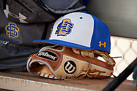 South Dakota State Jackrabbits hat and glove on the teams bench during a game against the FIU Panthers on February 23, 2019 at North Charlotte Regional Park in Port Charlotte, Florida.  South Dakota State defeated FIU 4-3.  (Mike Janes/Four Seam Images)