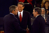Governor George W. Bush (Republican of Texas), left, United States Vice President Al Gore, center, and moderator Jim Lehrer, right, greet one another at the start of the third U.S. Presidential Debate at the Field House at Washington University in St. Louis, Missouri on October 17, 2000.<br /> Credit: Dennis Brack / Pool via CNP