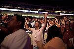 "Sunday, June 24, Raleigh, North Carolina.. California evangelist Greg Laurie, brought his ""Harvest Crusade"" to the RBC Center in Raleigh, NC for 3 days of music. prayer and Christian evangelism. Laurie brought together 200 local churches to sponsor the event which used 3000 volunteers and hopes to convert many newcomers to his version of born again Christianity.. Believers danced and prayed to the hour and a half long music program that preceded Laurie's sermon."