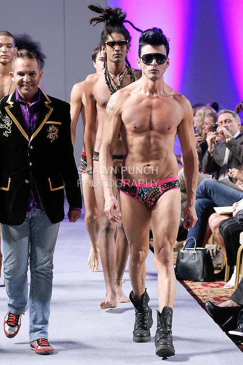 Model walks runway in swimwear from the Robert Flores collection, during Couture Fashion Week in New York City, September 15, 2012.