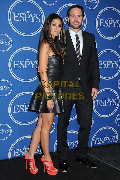 Emmanuelle Chriqui & Jimmie Johnson.2011 ESPY Awards - Press Room held at Nokia Theatre L.A. Live, Los Angeles, California, USA..July 13th, 2011.full length leather dress suit side red strappy platform shoes sandals strapless black smiling silver cuff bracelet.CAP/ADM/BP.©Byron Purvis/AdMedia/Capital Pictures.