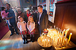 Family and children worship during Christmas Liturgy Service, St. Sava Serbian Orthodox Church, Jackson, Calif.