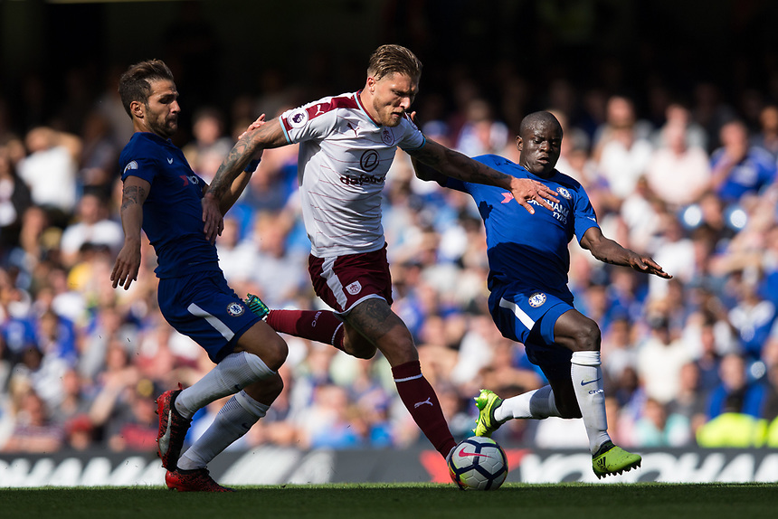Burnley's Jeff Hendrick under pressure from Chelsea's Ngolo Kante and Chelsea's Cesc Fabregas<br /> <br /> Photographer Craig Mercer/CameraSport<br /> <br /> The Premier League - Chelsea v Burnley - Saturday August 12th 2017 - Stamford Bridge - London<br /> <br /> World Copyright &copy; 2017 CameraSport. All rights reserved. 43 Linden Ave. Countesthorpe. Leicester. England. LE8 5PG - Tel: +44 (0) 116 277 4147 - admin@camerasport.com - www.camerasport.com