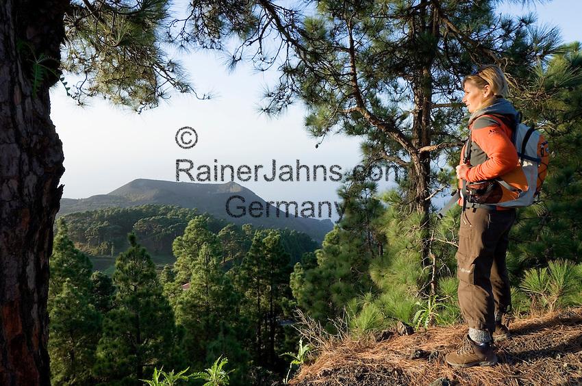Spain, Canary Islands, La Palma, view at vulcano San Antonio near village Los Canarios Fuencaliente, woman with backpack hiking