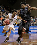 SIOUX FALLS, SD: MARCH 23: Justin Pitts #1 of Northwest Missouri State drives past Luquon Choice #20 of Lincoln Memorial during the Men's Division II Basketball Championship Tournament on March 23, 2017 at the Sanford Pentagon in Sioux Falls, SD. (Photo by Dick Carlson/Inertia)