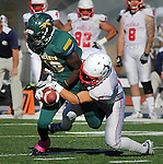 SPEARFISH, SD - OCTOBER 26, 2013:  Anthony Eboreime #18 of Black Hills State hangs onto a reception as Nick Henderson #6 of Colorado State - Pueblo tries to strip the ball during their Rocky Mountain Athletic Conference game Saturday at Lyle Hare Stadium in Spearfish, S.D. CSU-Pueblo won 51-17. (Photo by Dick Carlson/Inertia)