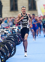 11 SEP 2010 - BUDAPEST, HUN - Jan Frodeno runs through transition at the end of a lap during the 2010 Elite Mens ITU World Championship Series Triathlon final (PHOTO (C) NIGEL FARROW)