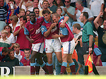 Mark Draper of Aston Villa (r) celebrates a goal on his debut with Ian Taylor (l) and Savo Milosevic (C)  - Barclays Premier League - Aston Villa v Manchester Utd - Villa Park Stadium - Birmingham - England - 19th August 1995 - Picture Sportimage