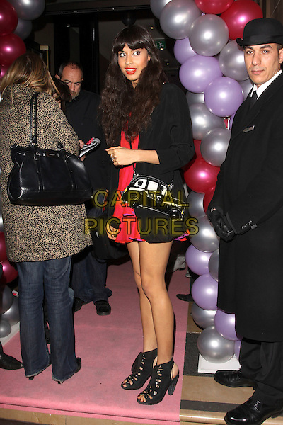 JAMEELA JAMIL .Attitude's Sweet 16 Birthday Party held at the Mayfair Hotel, London, England, UK..May 5th 2010 .full length red tiered dress black bag shooboots lace-up heels booties shoes open toe cut out car cab taxi shaped novelty cross body strap jacket .CAP/AH.©Adam Houghton/Capital Pictures.