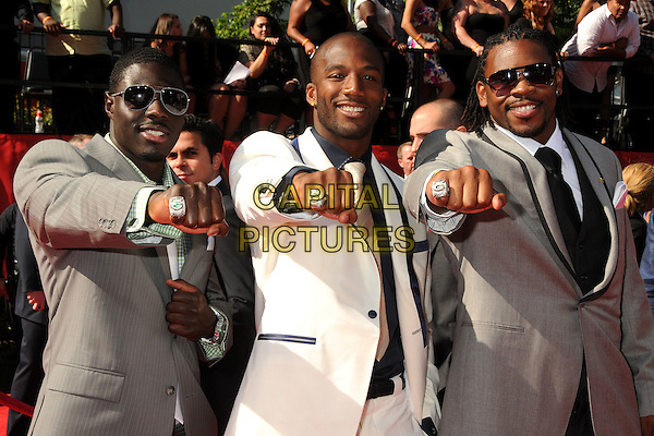 Charlie Peprah, Jarrett Bush and Desmond Bishop.2011 ESPY Awards - Arrivals held at Nokia Theatre L.A. Live, Los Angeles, California, USA..July 13th, 2011.half length white black grey gray suit jacket sunglasses shades hand hands fist fists ring rings.CAP/ADM/BP.©Byron Purvis/AdMedia/Capital Pictures.