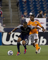 New England Revolution defender Darrius Barnes (25) attempts to control the ball as Houston Dynamo midfielder Alex Dixon (19) pressures. In a Major League Soccer (MLS) match, the New England Revolution tied Houston Dynamo, 1-1, at Gillette Stadium on August 17, 2011.