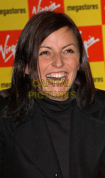 DAVINA McCALL.Launch of the Bo' Selecta Christmas single, the Sonny and Cher classic, I've Got You Babe, held at the Virgin Megastore, Oxford Street, central London. .December 13th, 2004 .headshot, portrait, laughing, teeth.www.capitalpictures.com.sales@capitalpictures.com.© Capital Pictures.