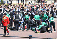 Guardsmen faints from the heat during Trooping the Colour, at Buckingham Palace, London, England, UK  June 09, 2018.<br /> CAP/GOL<br /> &copy;GOL/Capital Pictures