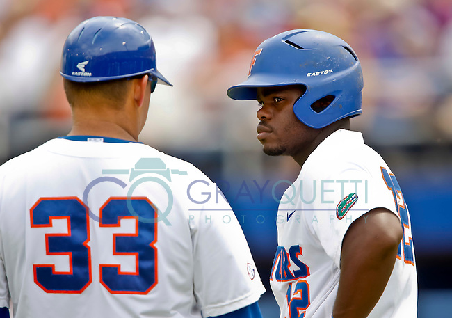 June 09, 2012:   Florida Gators inf Josh Tobias (12) talks with third base coach Craig Bell (33) during NCAA Gainesville Super Regional Game 1 action between Florida Gators and North Carolina State Wolfpack played at Alfred A. McKethan Stadium.    .......