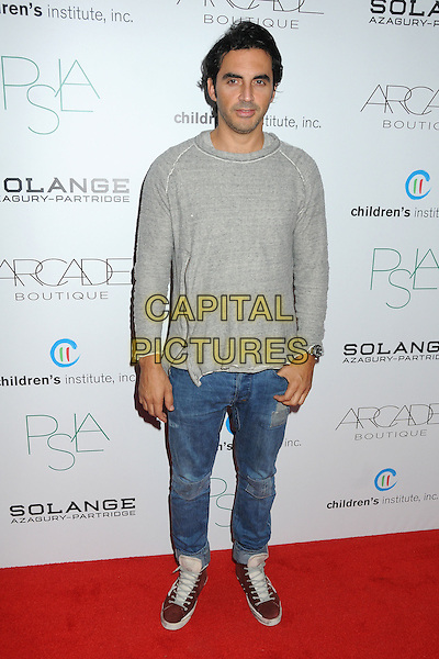 Yigal Azrouel.ARCADE Boutique's 2nd Annual Autumn Party held at The London West Hollywood Hotel, West Hollywood, California, USA..26th October 2011.full length grey gray top jeans denim  .CAP/ADM/BP.©Byron Purvis/AdMedia/Capital Pictures.