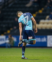 Luke O'Nien of Wycombe Wanderers checks his boots during the Sky Bet League 2 match between Notts County and Wycombe Wanderers at Meadow Lane, Nottingham, England on 10 December 2016. Photo by Andy Rowland.