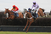 Race winner Tetlami ridden by Barry Geraghty (R) in jumping action ahead of Jackies Solitaire ridden by Noel Fehily in the Huntingdon Racecourse Novices Chase