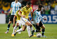 VIÑA DEL MAR - CHILE - 26-04-2015: James Rodriguez (Izq.) jugador de Colombia, disputan el balón con Lionel Messi (Der.) jugador de Argentina, durante partido Colombia y Argentina, por los cuartos de final, de la Copa America Chile 2015, en el estadio Sausalito en la Ciudad de Viña del Mar / James Rodriguez (L) player of Colombia, vies for the ball with Lionel Messi (R) player of Argentina, during a match between Colombia and Argentina, for the quarterfinals of the Copa America Chile 2015, in the Sausalito stadium in Viña del Mar city. Photo: VizzorImage /  Photosport / Martin Thomas / Cont.