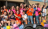 NWA Democrat-Gazette/BEN GOFF @NWABENGOFF<br /> The Rogers Heritage volleyball team rides in the school's homecoming parade Friday, Oct. 5, 2018, through downtown Rogers. This year's parade had a 'Candyland' theme.