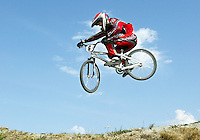 HERALD STAFF PHOTO BY NIKI DESAUTELS.DATE TAKEN: 090306..Tony Rundhaug gets some air as he flies over the McCollum BMX race track during a practice lap before the Sunday morning races on Sunday, Sept 3, 2006.