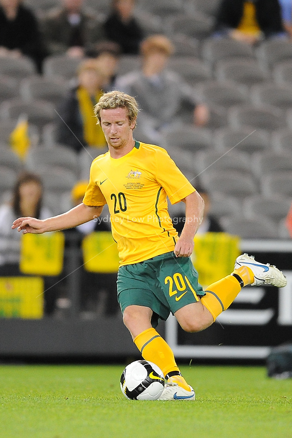 MELBOURNE, AUSTRALIA - OCTOBER 14: David Carney from Australia kicks the ball in a AFC Asian Cup 2011 match between Australia and Oman at Etihad Stadium on October 14, 2009 in Melbourne, Australia. Photo Sydney Low www.syd-low.com