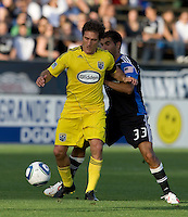 Guillermo Barros Schelotto of the Crew dribbles the ball away from Earthquakes' Steven Beitashour during the game at Buck Shaw Stadium in Santa Clara, California on June 2nd, 2010.  San Jose Earthquakes tied Columbus Crew, 2-2.