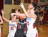 RICK PECK/SPECIAL TO MCDONALD COUNTY PRESS<br /> McDonald County's Rita Santillan gets fouled while driving to the basket between East Newton defenders Kendra Hickman (21) and Laney Jackson (31) during the Lady Mustangs' 35-32 win on Jan. 17 at East Newton High School.