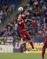 Real Salt Lake midfielder Will Johnson (8) and New England Revolution midfielder Stephen McCarthy (26) battle for head ball. In a Major League Soccer (MLS) match, Real Salt Lake defeated the New England Revolution, 2-0, at Gillette Stadium on April 9, 2011.