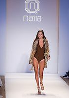 Model walks runway at Naila Collection Swimwear Show during Mercedes Benz IMG Fashion Swim Week 2013 at The Raleigh Hotel, Miami Beach, FL on July 23, 2012