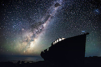 The Galactic Core of the Milky Way rises to the east, silhouetting and an old fishing boat that ran aground in a storm. The boat has been abandoned and makes for an interesting subject to photograph. I climbed up onto the boat that night and illuminated the cabin with a simple headlamp. This image is a single exposure photograph.