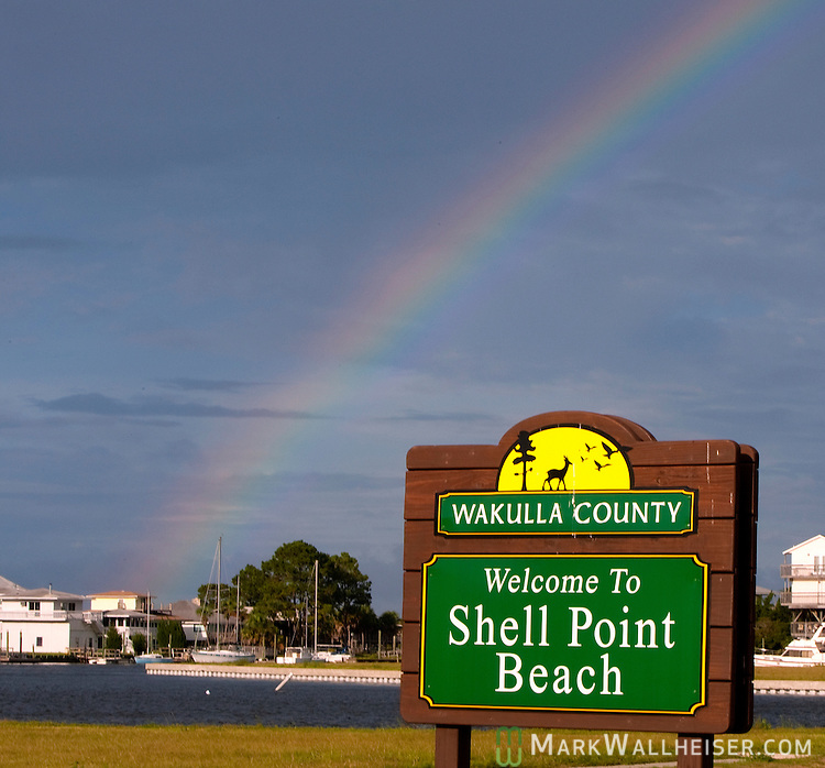 A rainbow comes out after a Florida afternoon summer rain shower at Shell Point, Florida.