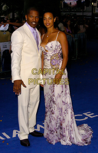 """JAMIE FOXX & GUEST.""""Miami Vice"""" UK film premiere, Odeon Leicester Square, London UK..July 27th, 2006.Ref: CAN.full length white suit purple floral print dress .www.capitalpictures.com.sales@capitalpictures.com.©Can Nguyen/Capital Pictures"""