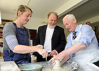 Dinny McGinley T.D., junior minister with responsibility for the Gaeltacht, rolled up his sleeves and  demonstrated his pottery skills as he created his own bowl while on a visit to the Louis Mulcahy Workshop at Clogher, Ballyferriter, Co. Kerry at the weekend. Looking on are Susie Ni Chearna and Louis Mulcahy. Picture: Eamonn Keogh (MacMonagle, Killarney)
