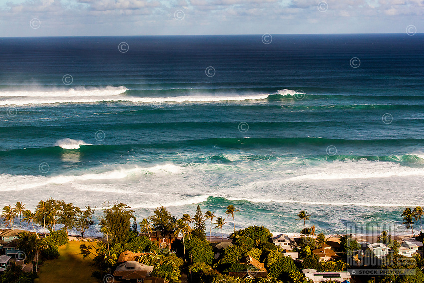 An aerial view of waves breaking during a large winter swell on the North Shore, O'ahu.