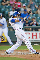 Round Rock Express first baseman Carlos Pena (33) swings the bat during the Pacific Coast League baseball game against the Fresno Grizzlies on June 22, 2014 at the Dell Diamond in Round Rock, Texas. The Express defeated the Grizzlies 2-1. (Andrew Woolley/Four Seam Images)