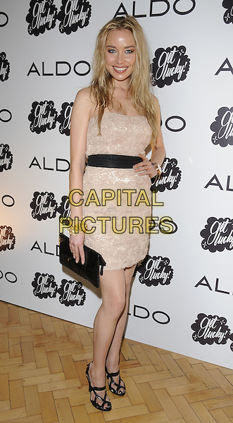 Noelle Reno.At the Aldo a/w 2011 collection party, One Marylebone, London, England, UK .21st June 2011..full length strapless beige dress lace hand on hip black sandals clutch bag watch smiling nude .CAP/CAN.©Can Nguyen/Capital Pictures.