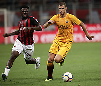 Calcio, Serie A: AC Milan - AS Roma, Milano stadio Giuseppe Meazza (San Siro) 31 agosto 2018. <br /> AS Roma's Edin Dzeko (r) in action with AC Milan's Franck Kessie (l) during the Italian Serie A football match between Milan and Roma at Giuseppe Meazza stadium, August 31, 2018. <br /> UPDATE IMAGES PRESS/Isabella Bonotto