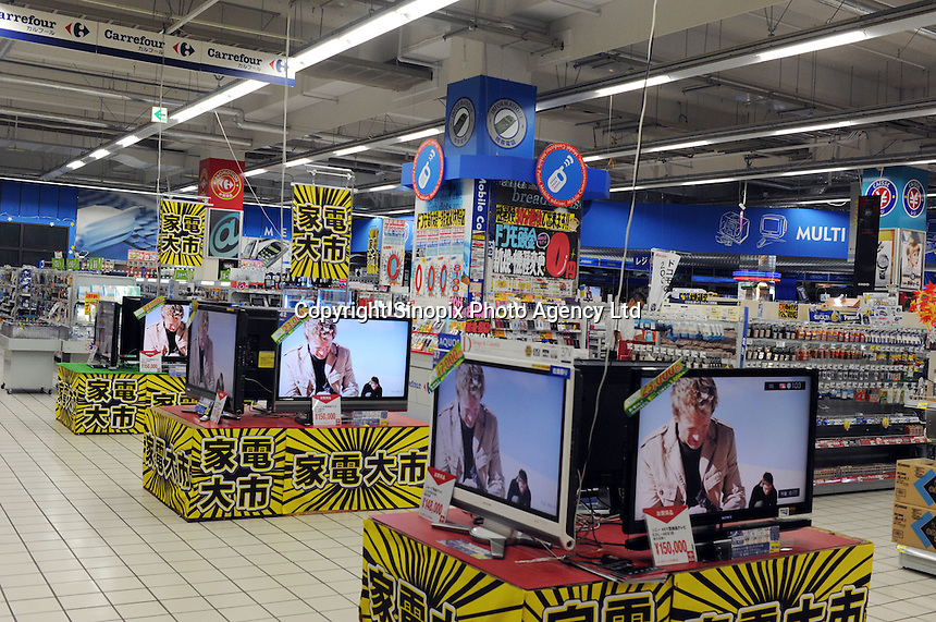 Televisions for sale at a branch of the French retailer Carrefour in Sayama, Saitama Prefecture, Japan. Carrefour sold it's stores to Japanese Company EON in 2005. The Sayama store was virtually deserted on Wednesday evening..