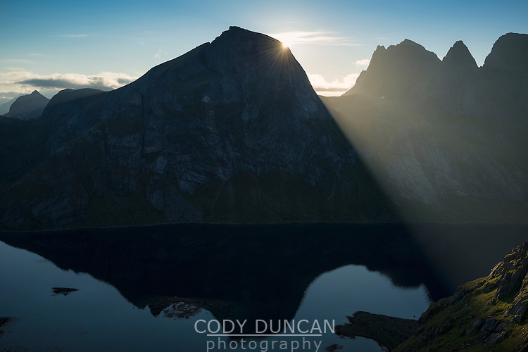 Sunrise behind Rostadtindan from near Helvetestinden, Moskenesoy, Lofoten Islands, Norway