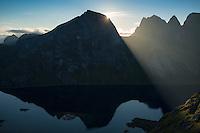 Sunrise behind Rostadtindan from near Helvetestinden, Moskenesoy, Lofoten Islands, Norway