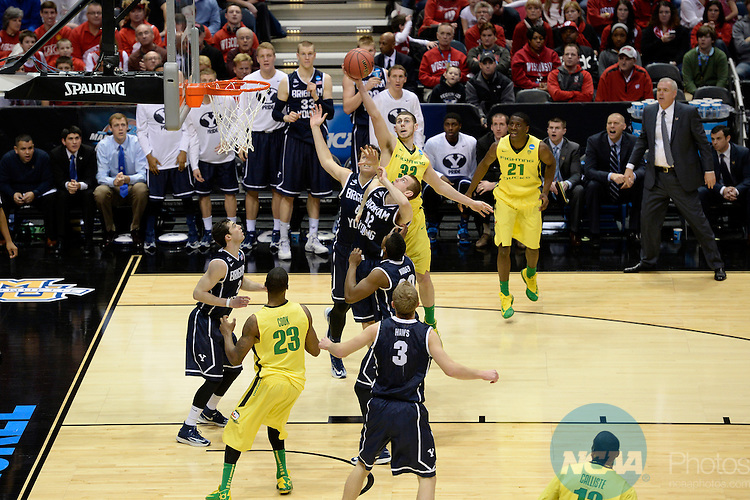 20 MAR 2014:  The University of Oregon and Brigham Young University battle for a rebound during the second round of the 2014 NCAA Men's Basketball Tournament held at the BMO Harris Bradley Center in Milwaukee, WI.  Oregon defeated BYU 87-68.  Jamie Schwaberow/NCAA Photos