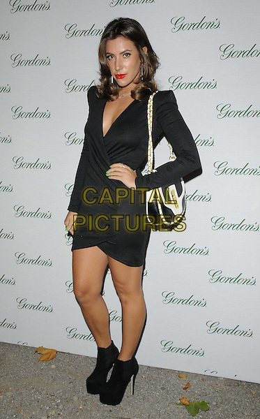 Gabriella Ellis.The Gordon's Gin Limited Edition Bottle launch party, One Marylebone, Marylebone Rd., London, England..September 12th, 2012.full length black hand on hip dress ankle boots bag purse white .CAP/CAN.©Can Nguyen/Capital Pictures.