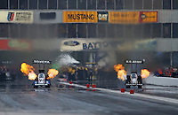 Apr. 26, 2013; Baytown, TX, USA: NHRA top fuel dragster driver Antron Brown (left) races alongside teammate Tony Schumacher during qualifying for the Spring Nationals at Royal Purple Raceway. Mandatory Credit: Mark J. Rebilas-