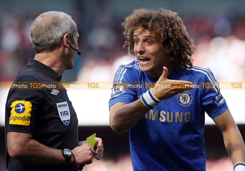 David Luiz of Chelsea argues with referee Martin Atkinson after he had received a yellow card - Arsenal vs Chelsea - Barclays Premier League at the Emirates Stadium, Arsenal 29/09/12 - MANDATORY CREDIT: Rob Newell/TGSPHOTO - Self billing applies where appropriate - 0845 094 6026 - contact@tgsphoto.co.uk - NO UNPAID USE.